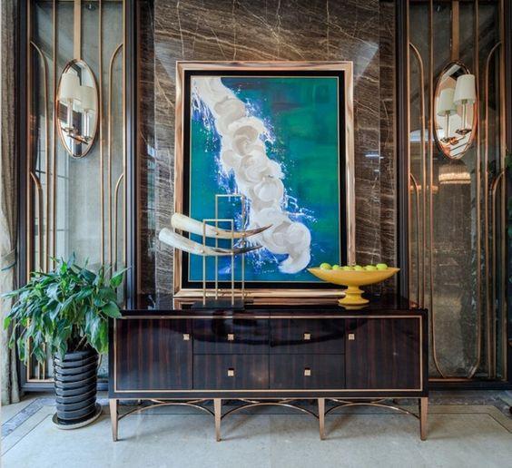 欧式风格玄关 抽象油画 象牙摆件 大理石背景墙